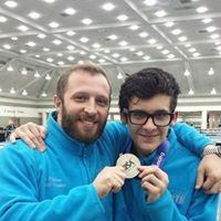 Lucas Wetmore, right, of Westport with his coach, Joe Fisherof New Amsterdam Fencing Academy North, will compete in this weekend's Junior Olympics Photo: Contributed / Photo