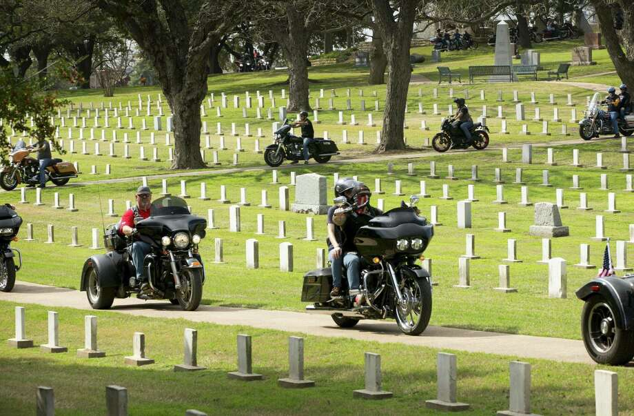 Bikers ride in the Texas State Cemetery in Austin during the Combat Veterans Motorcycle Association Chris Kyle Memorial Ride. Photo: Photos By Jay Janner /Austin American-Statesman / Austin American-Statesman