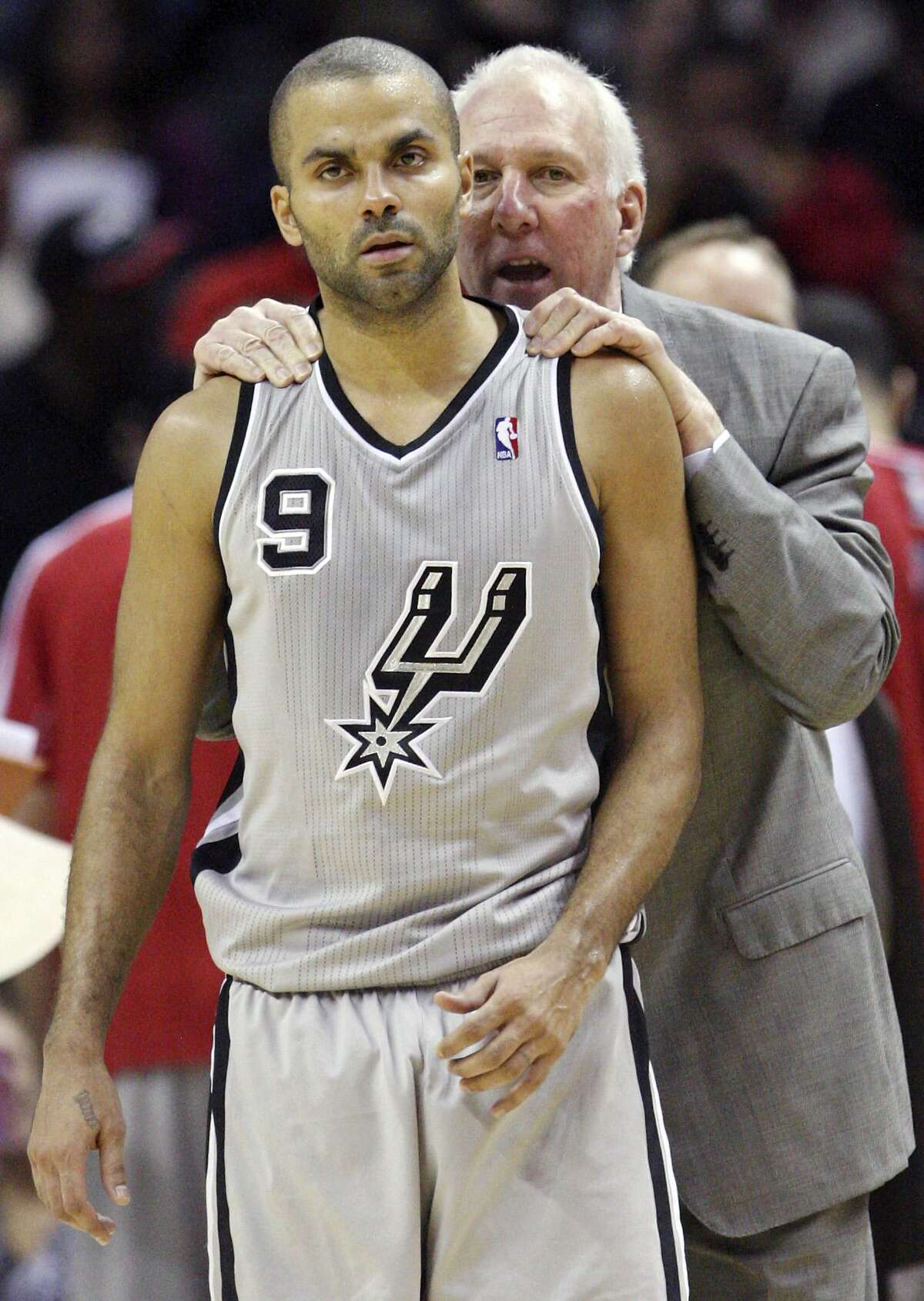 Coach Gregg Popovich encourages Tony Parker during a home game against Memphis in 2012.