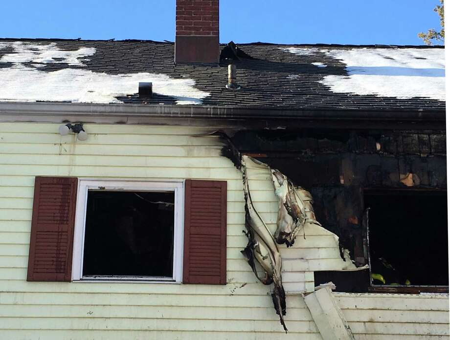 A fire extensively damaged a home at 14 Kettle Road in Norwalk, Conn. on Monday, Jan. 13, 2017. The fire, reported shortly before 8 a.m., was located on the second floor and attic area of the two and one-half-story house. Photo: Leslie Lake / Hearst Connecticut Media / Norwalk Hour