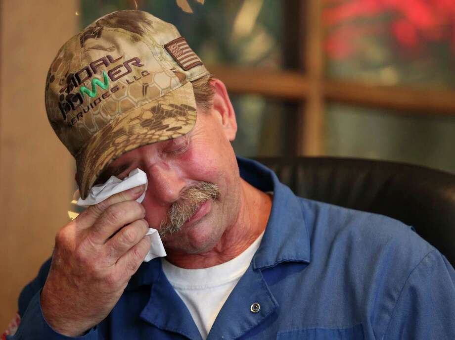 Charles Rayburn, 57, wipes away tears while sharing stories of fighting against right parotid gland cancer, which was surgically removed in 2012 after a 19-hour surgery, Thursday, Dec. 15, 2016, in Houston. Rayburn lives along San Jacinto River his whole life and went boating and swimming on and in the River as often as he could. Photo: Yi-Chin Lee, Houston Chronicle / © 2016  Houston Chronicle