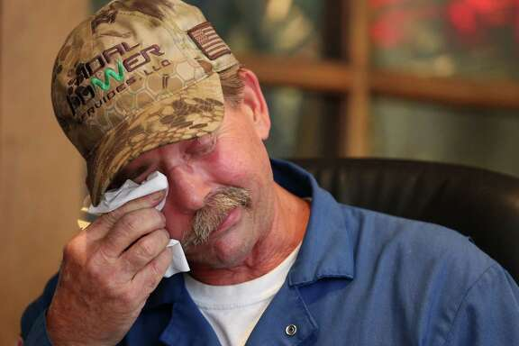 Charles Rayburn, 57, wipes away tears while sharing stories of fighting against right parotid gland cancer, which was surgically removed in 2012 after a 19-hour surgery, Thursday, Dec. 15, 2016, in Houston. Rayburn lives along San Jacinto River his whole life and went boating and swimming on and in the River as often as he could.