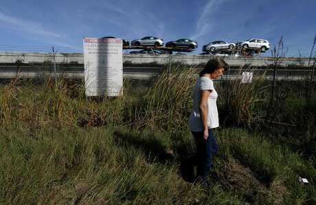 In January, long-time resident Gina Fields visited the San Jacinto Waste Pits Superfund Site. Experts have long predicted that a major hurricane could release dioxins and other waste into the river. Photo: Melissa Phillip, Houston Chronicle / © 2016 Houston Chronicle