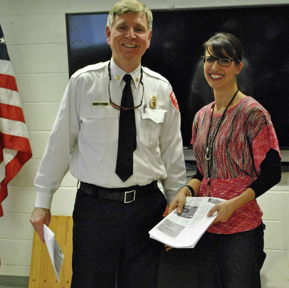 Danbury Fire Chief TJ Wiedl and Mary Arconti Gregory, director of the Danbury Schools and Business Collaborative Photo: / Submitted Photo