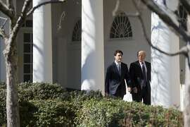 US President Donald Trump and Canadian Prime Minister Justin Trudeau walk down the West Wing Colonnade between meetings at the White House in Washington, DC, February 13, 2017. / AFP PHOTO / SAUL LOEBSAUL LOEB/AFP/Getty Images