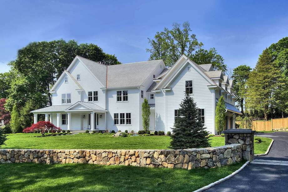 The newly constructed colonial house at 9 Burr Farms Road has 10,885 square feet of living space on four finished floors.