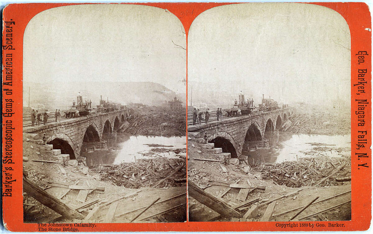 Photographic stereo view features a construction crew repairing a bridge damaged in a flood, Johnstown, Pennsylvania, 1889. (Photo by Transcendental Graphics/Getty Images)