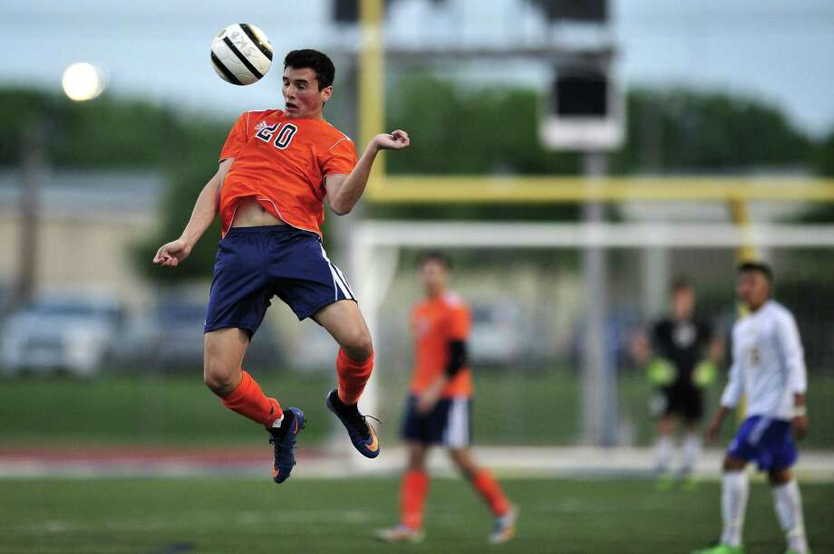 Brandeis's Marlon Flores controls the ball in the air during the Class 6A third-round boys playoff game between Brandeis and Clemens at Clemens High School on Tuesday, April 7, 2015 in San Antonio. Brandeis won the game 4 - 0. Photo: Matthew Busch, For The San Antonio Express-News / For San Antonio Express-News / © Matthew Busch