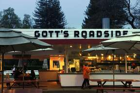 "Taylor's Refresher in St. Helena, Calif., has had a name change to Gott's Roadshide. This photo shows the much-beloved establishment on Monday, March 29, 2010, about a week after the name change took place. If Lloyd ""Popsy"" Taylor could see what the Gott brothers have done to his 1949 St. Helena drive-in he'd be rolling in his grave.This week, with much fanfare, Joel and Duncan Gott changedthe name of the landmark hamburger joint from Taylor's Refresher to Gott's Roadside Tray Gourmet. And the late Taylor's two daughters, Jean Taylor Nicholson, 83, and Virginia Taylor Toogood, 80, are furious."