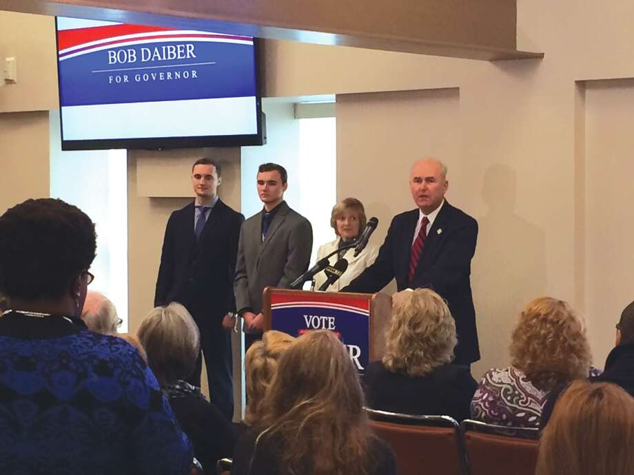 Bob Daiber, right, with his wife and sons in attendance, announces his bid for Illinois Governor during a press conference Monday at the Mannie Jackson Center for the Humanities in Edwardsville. Photo: John Sommerhof • Intelligencer
