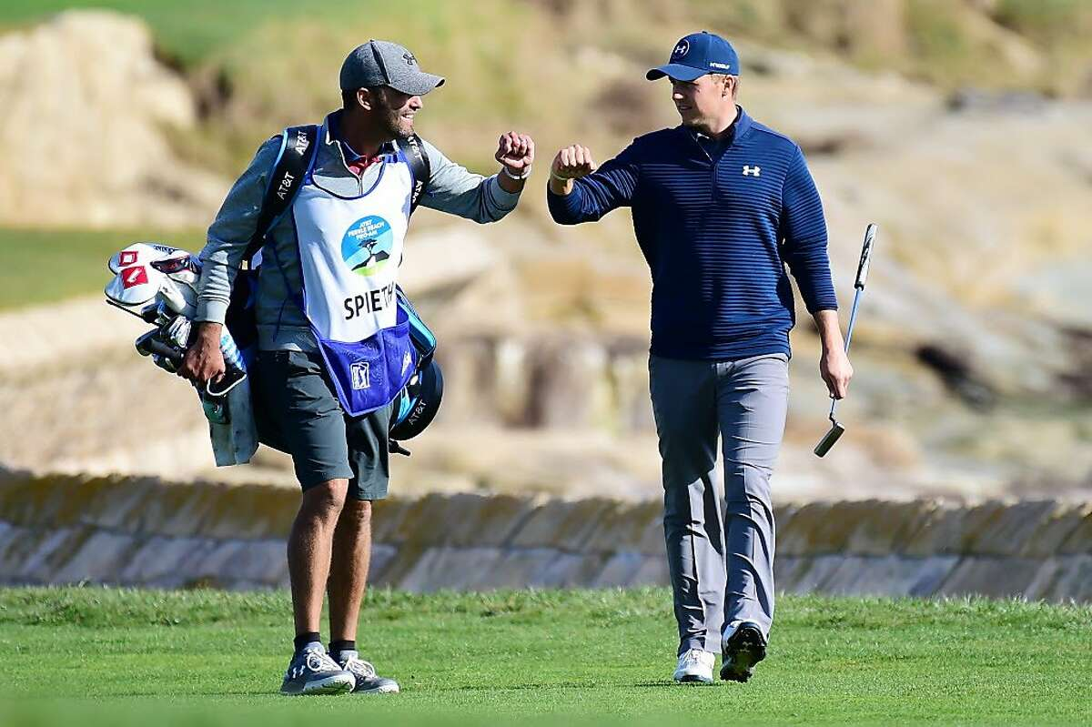 PEBBLE BEACH, CA - FEBRUARY 12: Jordan Spieth celebrates with his caddie on the 18th hole during the final round of the AT&T Pebble Beach Pro-Am at Pebble Beach Golf Links on February 12, 2017 in Pebble Beach, California. (Photo by Harry How/Getty Images)