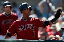 Jean Segura of the Arizona Diamondbacks high-fives teammates in the dugout after hitting a solo home run against the Oakland Athletics during the first inning of the spring training game at Salt River Fields at Talking Stick on March 4, 2016 in Scottsdale, Arizona.  (Photo by Christian Petersen/Getty Images)