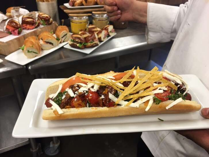 BBVA Compass Stadium's El Grande Jefe Colombian Dawg features a two-foot hot dog,  creamy sweet salsa, crushed sea salt potato chips and pineapple crema, $25.