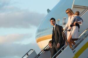 Ivanka Trump, daughter of US President Donald Trump, her husband Jared Kushner, senior adviser to Trump, and their children walk off Air Force One at Palm Beach International Airport in Florida as they arrive to spend the weekend at Trump's Mar-a-Lago resort on February 10, 2017 with Japanese Peime Minister Shinzo Abe and his wife Akie. / AFP / NICHOLAS KAMM        (Photo credit should read NICHOLAS KAMM/AFP/Getty Images)
