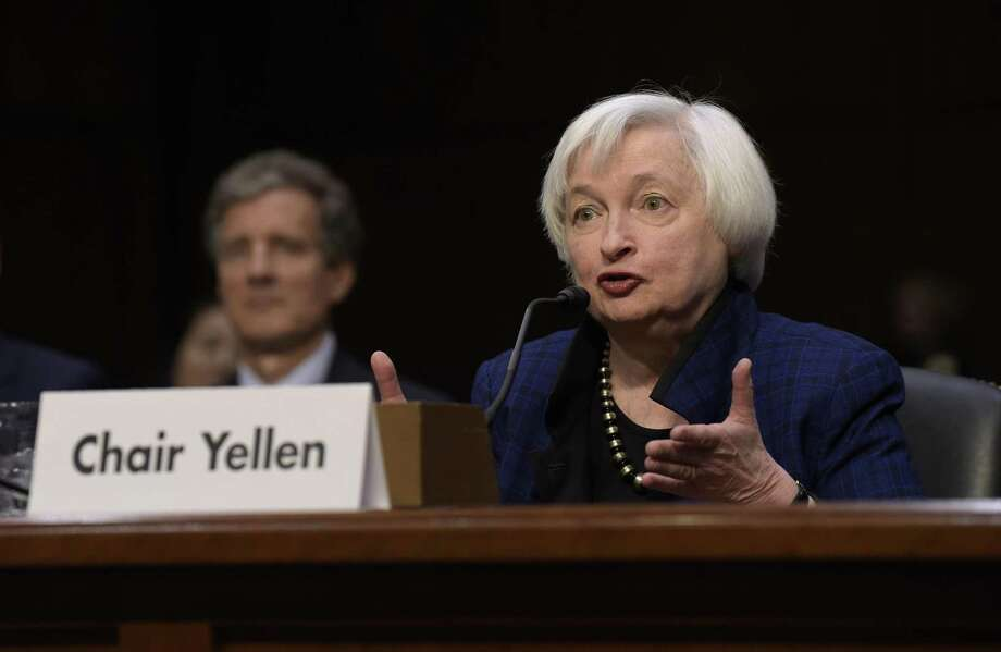 Federal Reserve Chair Janet Yellen testifies Nov. 17 before the Joint Economic Committee. Yellen is expected to be pressed to clarify the Fed's outlook for interest rates and its view of the uncertainties of President Donald Trump's economic program when she gives her semiannual testimony to Congress beginning Tuesday. Photo: Susan Walsh /Associated Press / Copyright 2016 The Associated Press. All rights reserved.