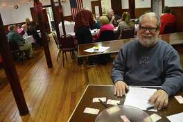 Bill Kruppenbacher served as ticket taker at the Greenfield Hill Grange's Valentine fundraiser dinner, Saturday, Feb. 11, 2017, in Fairfield, Conn.