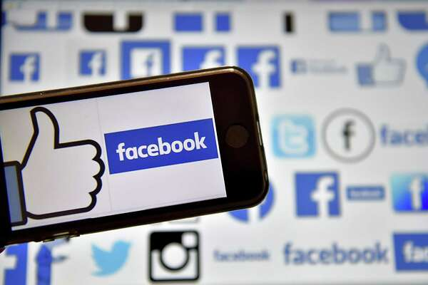 "(FILES) This file photo taken on December 28, 2016  shows logos of US online social media and social networking service Facebook in Vertou, western France. Facebook on February 8, 2017 updated its Safety Check feature with a way for people to lend, or get, helping hands after disasters. A new ""Community Help"" feature provides a forum at the leading social network where assistance can be offered to victims of floods, earthquakes, fires or other kinds of natural or accidental tragedy, according to Facebook vice president of social good Naomi Gleit.  / AFP PHOTO / LOIC VENANCELOIC VENANCE/AFP/Getty Images"