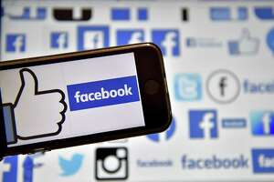 """(FILES) This file photo taken on December 28, 2016  shows logos of US online social media and social networking service Facebook in Vertou, western France. Facebook on February 8, 2017 updated its Safety Check feature with a way for people to lend, or get, helping hands after disasters. A new """"Community Help"""" feature provides a forum at the leading social network where assistance can be offered to victims of floods, earthquakes, fires or other kinds of natural or accidental tragedy, according to Facebook vice president of social good Naomi Gleit.  / AFP PHOTO / LOIC VENANCELOIC VENANCE/AFP/Getty Images"""