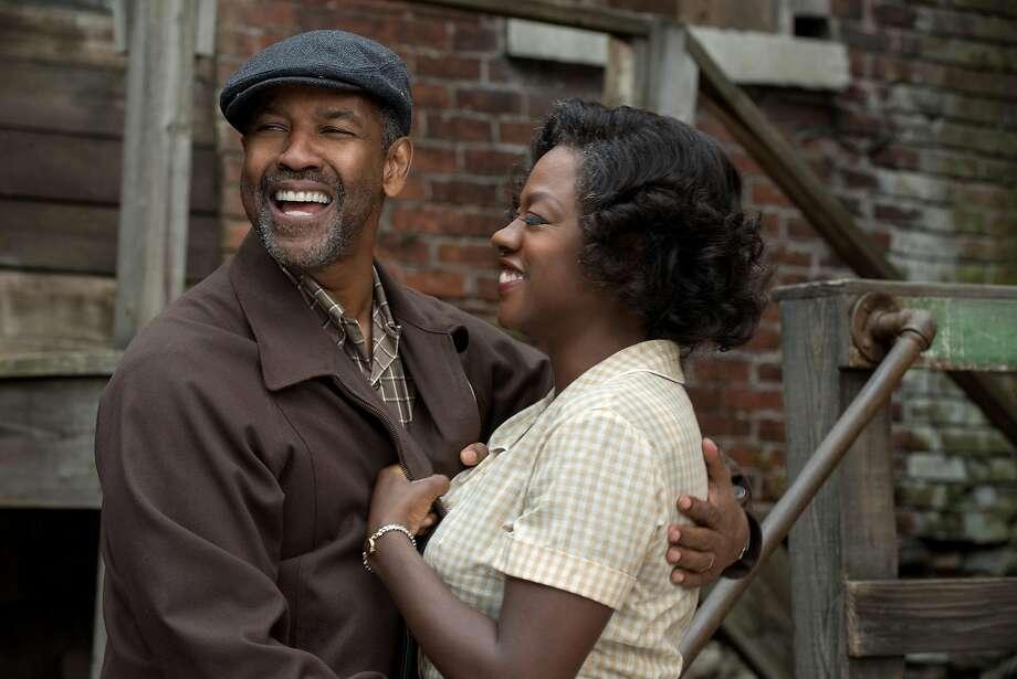 "Denzel Washington as Troy Maxson and Viola Davis as Rose Maxson in a scene from the movie ""Fences."" Photo: David Lee, TNS"