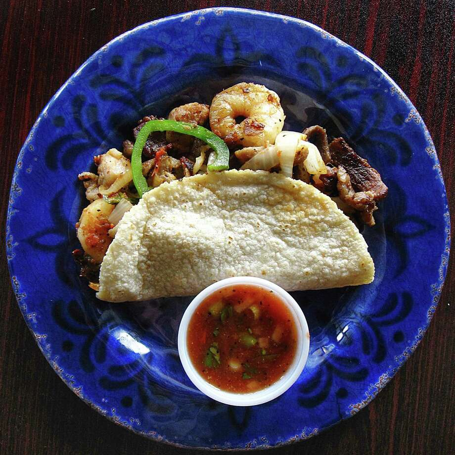 "Tacof of the Week: ""A La Casa"" taco with grilled shrimp, chicken and beef on a handmade corn tortilla from Don Jose Mexican Cafe. Photo: Mike Sutter /San Antonio Express-News"