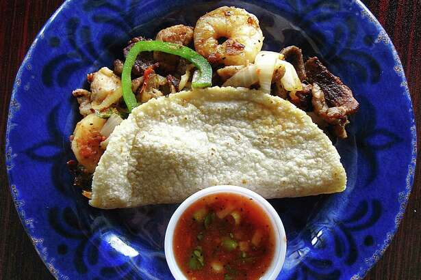 """Tacof of the Week: """"A La Casa"""" taco with grilled shrimp, chicken and beef on a handmade corn tortilla from Don Jose Mexican Cafe."""