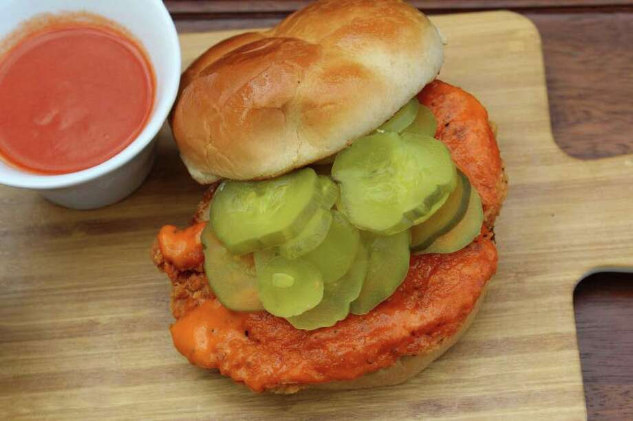 BBVA Compass Stadium's new food selections include the Houston Hot Chicken Sandwich, spicy fried chicken breast with honey butter, spicy sauce and cheddar cheese. Photo: Levy Restaurants
