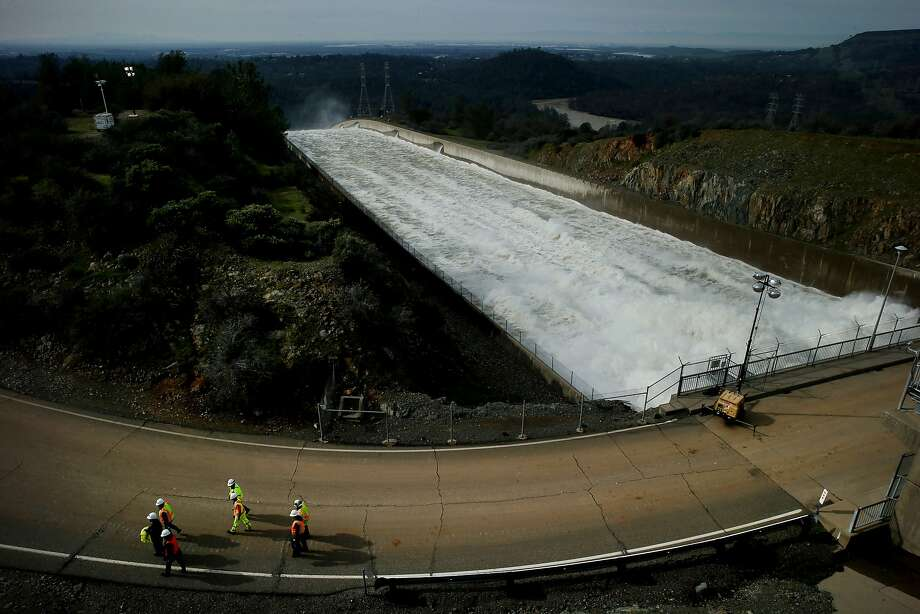 Officials inspect the Oroville Dam for damage on Monday, the day after nearly 200,000 people downriver from the reservoir were ordered to evacuate. Photo: Santiago Mejia, The Chronicle