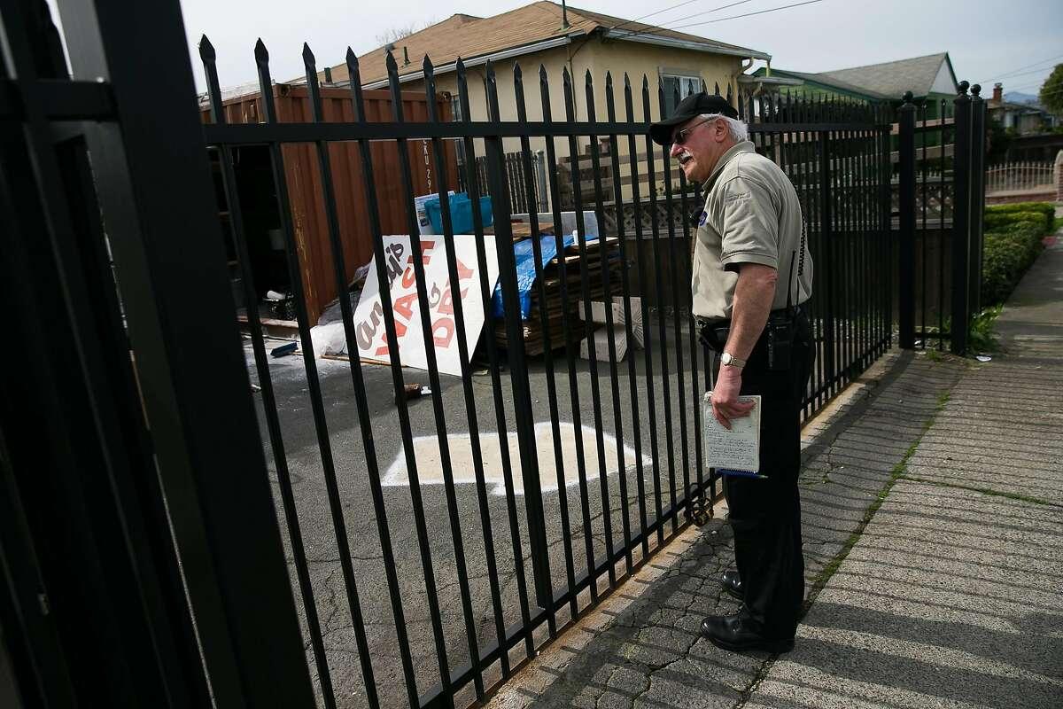 Code enforcement officer, David Rogowski, checks on a property in Richmond, Calif. Monday, February 13, 2017.