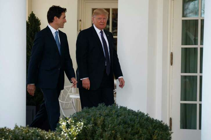 President Donald Trump and Canadian Prime Minister Justin Trudeau walk to lunch at the White House in Washington, Monday, Feb. 13, 2017. (AP Photo/Evan Vucci)