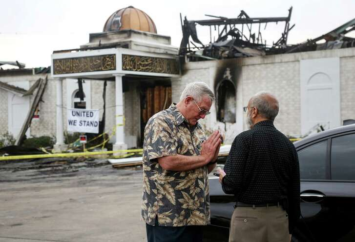 Bill Pozzi, left, offers his help and condolences to Shahid Hashmi, the president of the Victoria Islamic Center. The center was destroyed in a firm on Jan. 28. The community has rallied to help the mosque. ( Jon Shapley / Houston Chronicle )