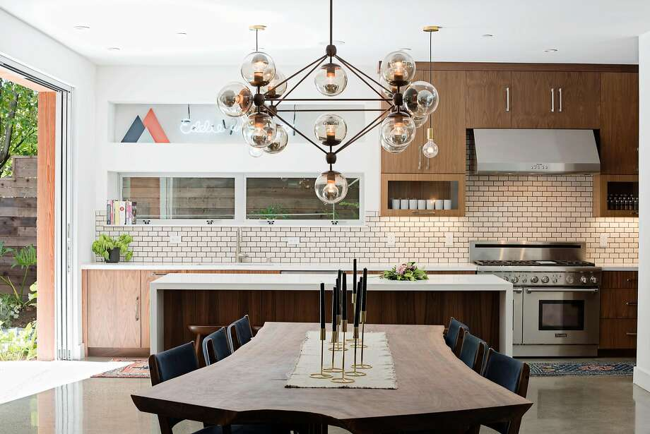 Anchoring the kitchen is a 10-foot live-edge claro walnut dining table chosen for a natural split at one end. Photo: Sarah Hebenstreit, Modern Kids Co.