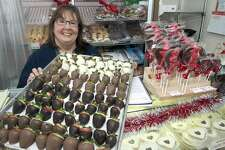 Laurie Petreycik poses with a tray of chocolate dipped strawberries for Valentine's Day at Tidmarsh's Home Bake Shop in Ansonia, Conn. Feb. 13, 2017. Petreycik has kept the shop open after the death of its founder, Roy Tidmarsh, last year.