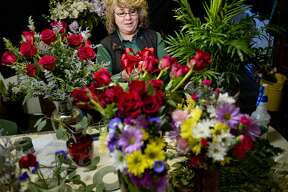 Mary Rheaume works on Valentine's Day orders at Randi's Green Thumb Plants & Flowers on Monday in Midland. Local flower shops are in full gear making arrangements and preparing flowers and orders for customers for Valentine's Day.