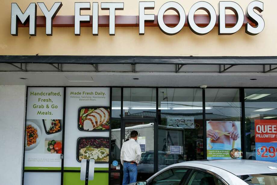 Glenn Fahl peers into the now-closed My Fit Foods off Shepherd. The company started in Houston and moved its headquarters to Austin. Photo: Michael Ciaglo, Staff / Michael Ciaglo