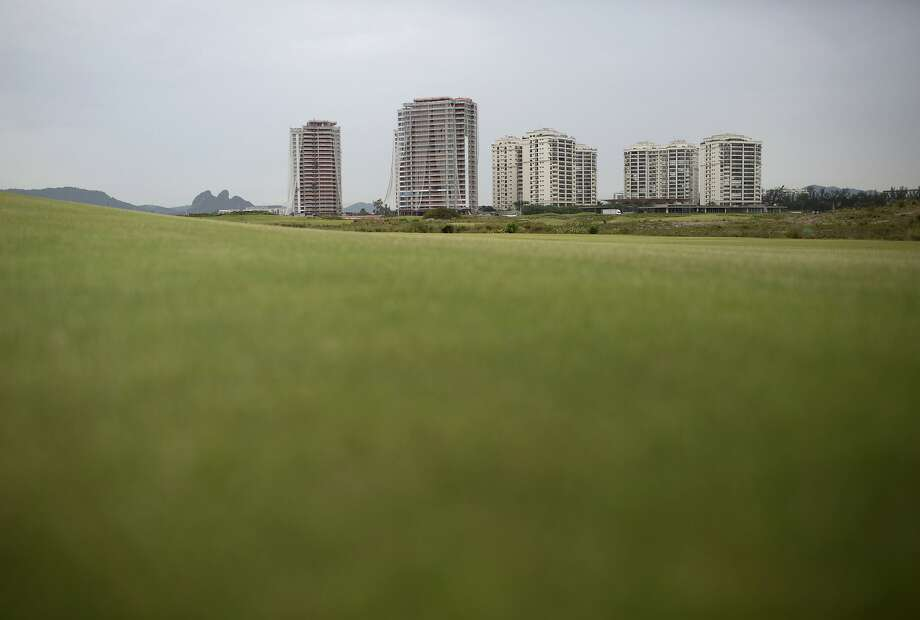 """FILE - This Dec. 14, 2016 file photo shows luxury apartments known as """"Riserva Golf,"""" off the Olympic golf course in Rio de Janeiro, Brazil, which won't be completed until 2018.  Photo: Silvia Izquierdo, Associated Press"""