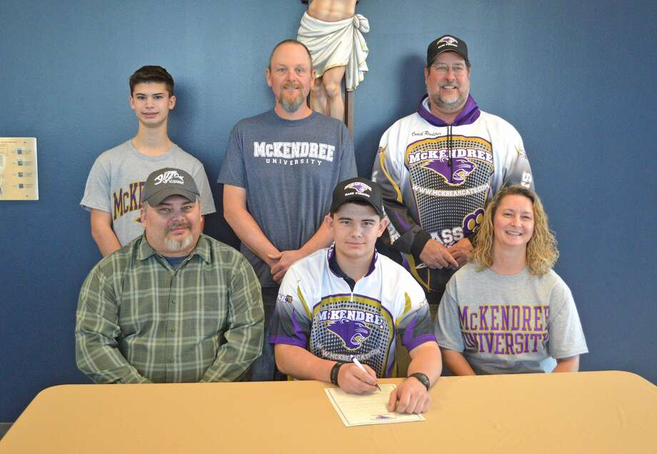Father McGivney senior Ethan Jones recently signed to compete in bass fishing for McKendree University. In the front row, from left to right, are father Walter Jones, Ethan Jones and mother Tia Jones. In the back row, from left to right, are brother Blake Jones, Father McGivney coach Brian Helm and McKendree coach Jon Rinderer.