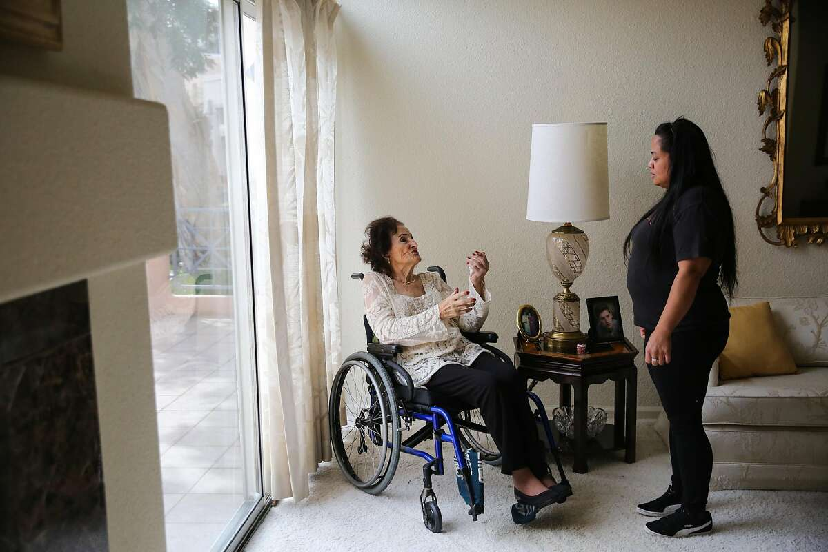 Lee Savasta who is about to turn 100 chats with her caretaker Annabelle Tadina (right) during a portrait session at her home in Redwood City, California, on Monday, Feb. 13, 2017.
