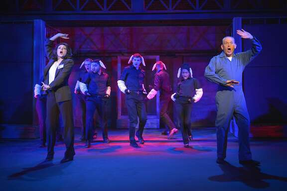 "Rookie FBI agent Clarice Starling (Anne Norland), Dr. Hannibal Lecter (Scott Hayes) and a chorus of lambs in ""Silence! The Musical"" at Victoria Theatre."