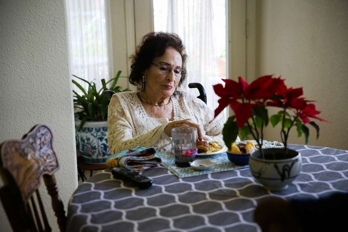 Lee Savasta who is about to turn 100 eats a ham sandwich for lunch at her home in Redwood City, California, on Monday, Feb. 13, 2017.
