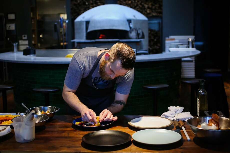 Chef Jeffrey Hayden plates the roasted beet and winter citrus salad. Photo: Gabrielle Lurie, The Chronicle
