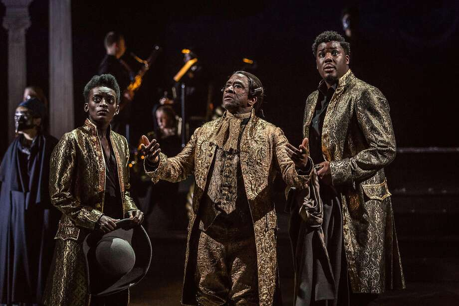 "Sarah Amankwah, Lucian Msamati, Hammed Animashaun in ""Amadeus."" Photo: Marc Brenner, National Theatre Live"