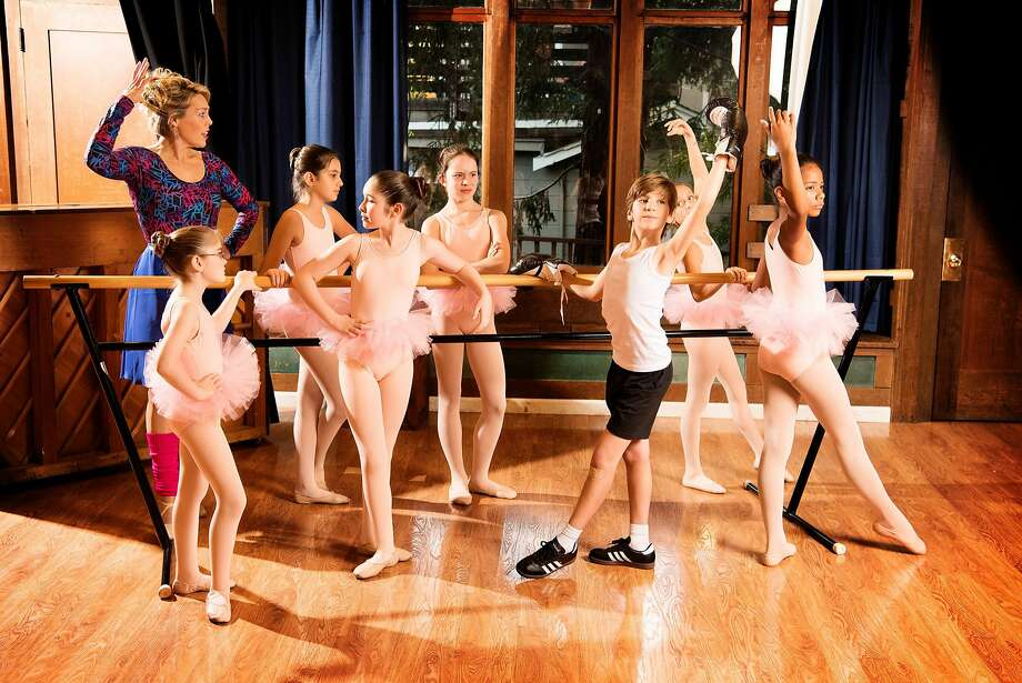 """Billy Elliot (Parker James Fullmore) stands out from the crowd with the ballet girls and Mrs. Wilkinson (Taylor Bartolucci) in Berkeley Playhouse's """"Billy Elliot."""" Photo: Ben Krantz Studio, Berkeley Playhouse"""