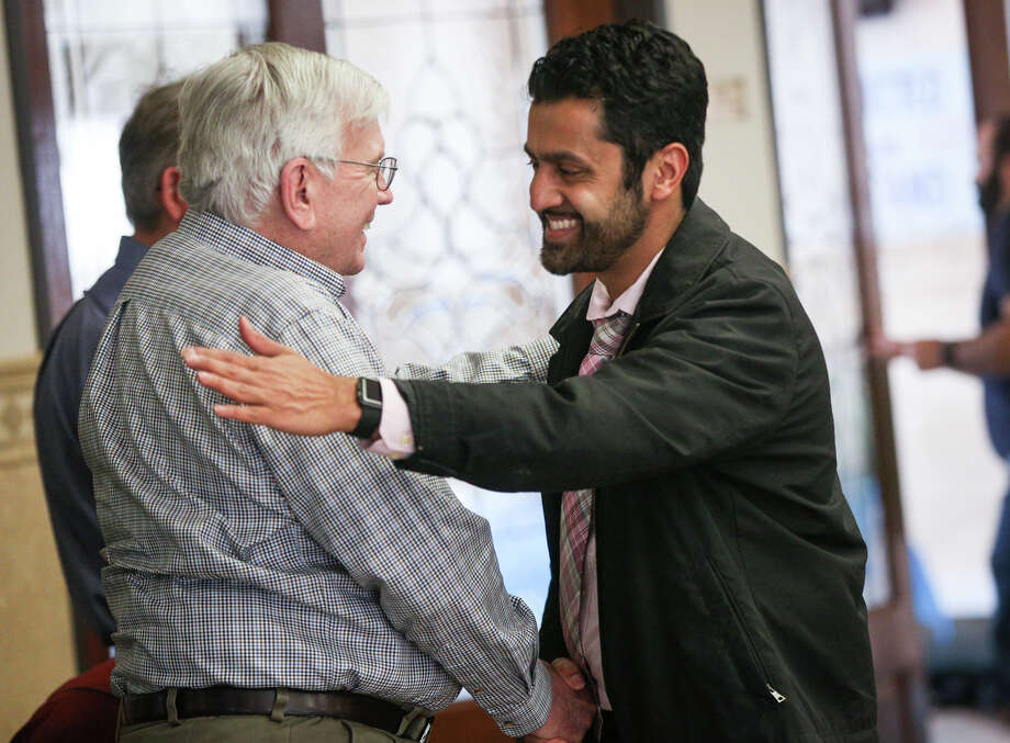 Bill McCleary, of Woodlands Community Presbyterian Church, left, is greeted by a member of The Woodlands Mosque after a prayer service. Muslims there are receiving shows of support from neighbors. Photo: Michael Minasi, Staff Photographer / © 2017 Houston Chronicle