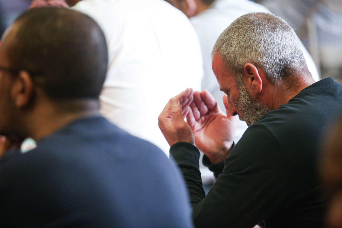 A worshiper prays during the service on Friday, Feb. 3, 2017, at The Woodlands Mosque.