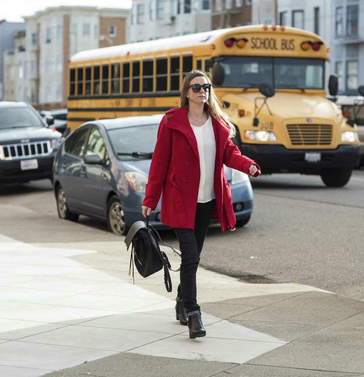 Hilary Elfman, a special education teacher at a city elementary school, walks home after work from her job in Pacific Heights to her parent's apartment in the Marina District in San Francisco, Calif., on Friday, February 10, 2017.