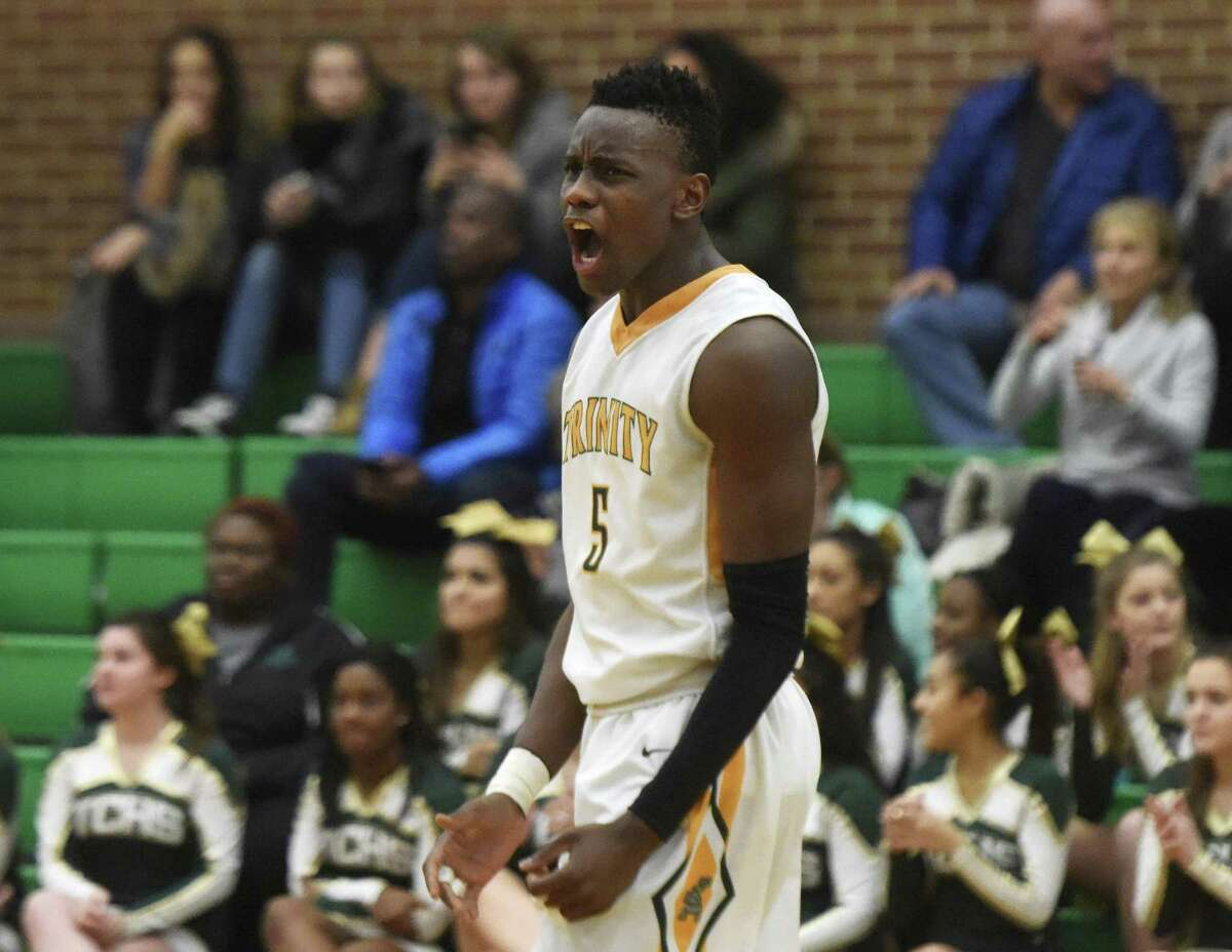 Trinity Catholic's Cantavio Dutrel celebrates after his team scores in Trinity Catholic's 73-65 win over Greenwich in the high school boys basketball game at Trinity Catholic High School in Stamford, Conn. Monday, Feb. 13, 2017.