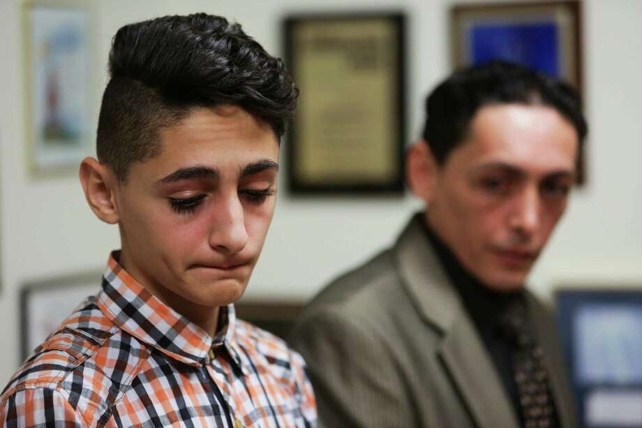 Mohammad Abu Khadra, 16, left, lives in Katy with his brother, Rami Abu Khadra, right. A native of Jordan, he was detained late last month. Photo: Michael Ciaglo, Staff / Michael Ciaglo