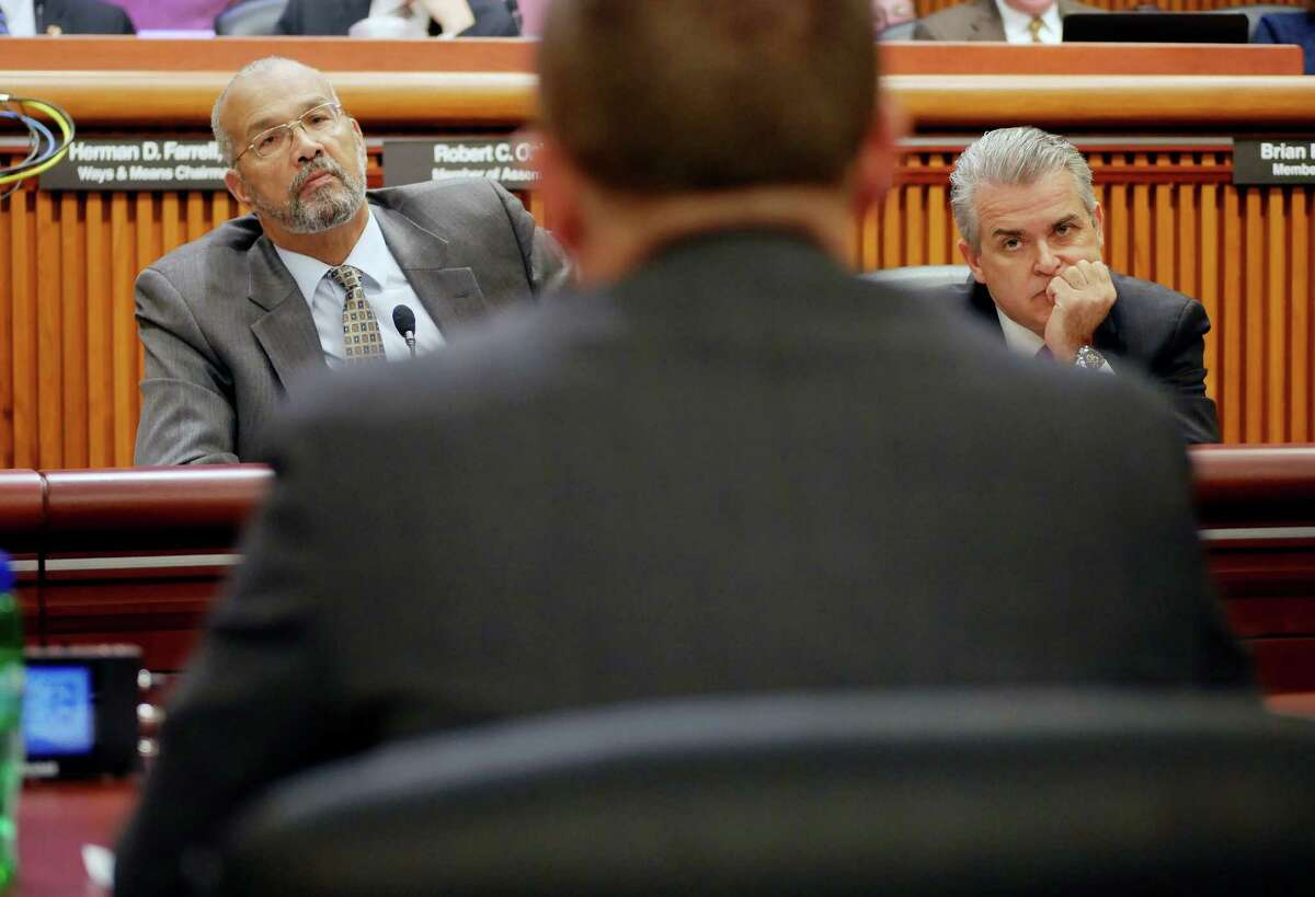 Assemblyman Jeffrion Aubry, left, and Assemblyman Steve McLaughlin listen as New York State Department of Environmental Conservation Commissioner Basil Seggos testifies before the State Legislature Joint Budget Hearing on Environmental Conservation on Monday, Feb. 13, 2017 in Albany, N.Y. (Paul Buckowski / Times Union)