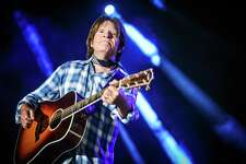 John Fogerty, shown performing last year in California, wore his signature western plaid shirt for his first San Antonio Stock Show & Rodeo performance.