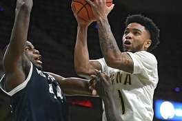 Siena's Marquis Wright is defended by Monmouth's  Sam Ibiezugbe as he drives to the basket during a basketball game at the Times Union Center on Monday, Feb. 13, 2017 in Albany, N.Y. (Lori Van Buren / Times Union)